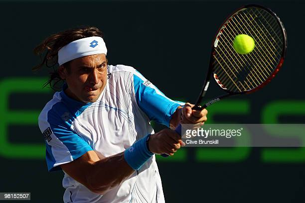 David Ferrer of Spain returns a shot against Rafael Nadal of Spain during day eight of the 2010 Sony Ericsson Open at Crandon Park Tennis Center on...