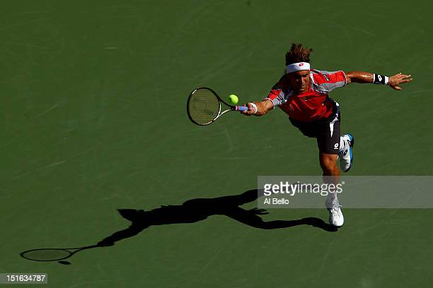 David Ferrer of Spain returns a shot during his men's singles semifinal match against Novak Djokovic of Serbia on Day Fourteen of the 2012 US Open at...