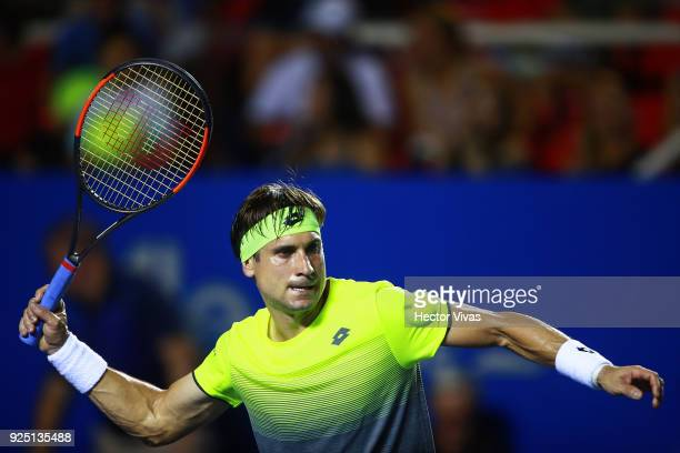 David Ferrer of Spain returns a shot during the match between David Ferrer of Spain and Andrey Rublev of Russia as part of the Telcel Mexican Open...