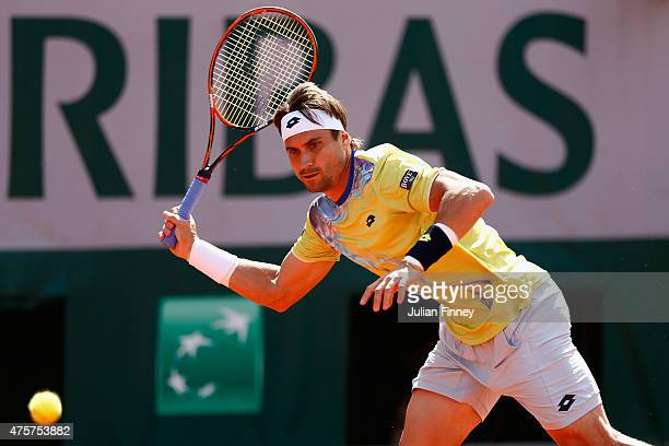 David Ferrer of Spain returns a shot in his Men's quarter final match against Andy Murray of Great Britain on day eleven of the 2015 French Open at...