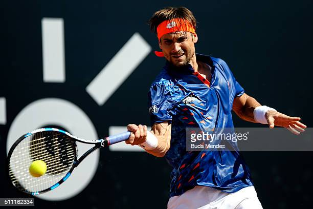 David Ferrer of Spain returns a shot to Albert RamosVinolas of Spain during the Rio Open at Jockey Club Brasileiro on February 18 2016 in Rio de...