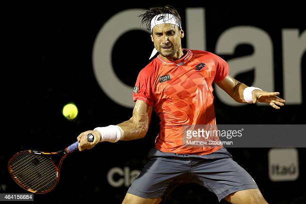 David Ferrer of Spain returns a shot to Fabio Fognini of Italy during the final of the Rio Open at the Jockey Club Brasileiro on February 22, 2015 in...