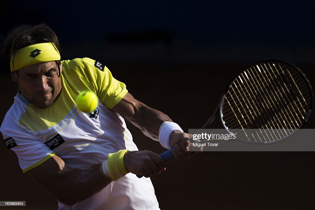 David Ferrer of Spain returns the ball during a tennis match against Paolo Lorenzi of Italy as part of the Mexican Tennis Open Acapulco 2013 at Pacific resort on February 28, 2013 in Acapulco, Mexico.
