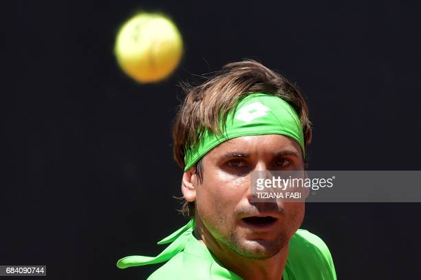David Ferrer of Spain returns the ball to Japanese tennis player Kei Nishikori during their match at the ATP Tennis Open tournament on May 17 2017 at...