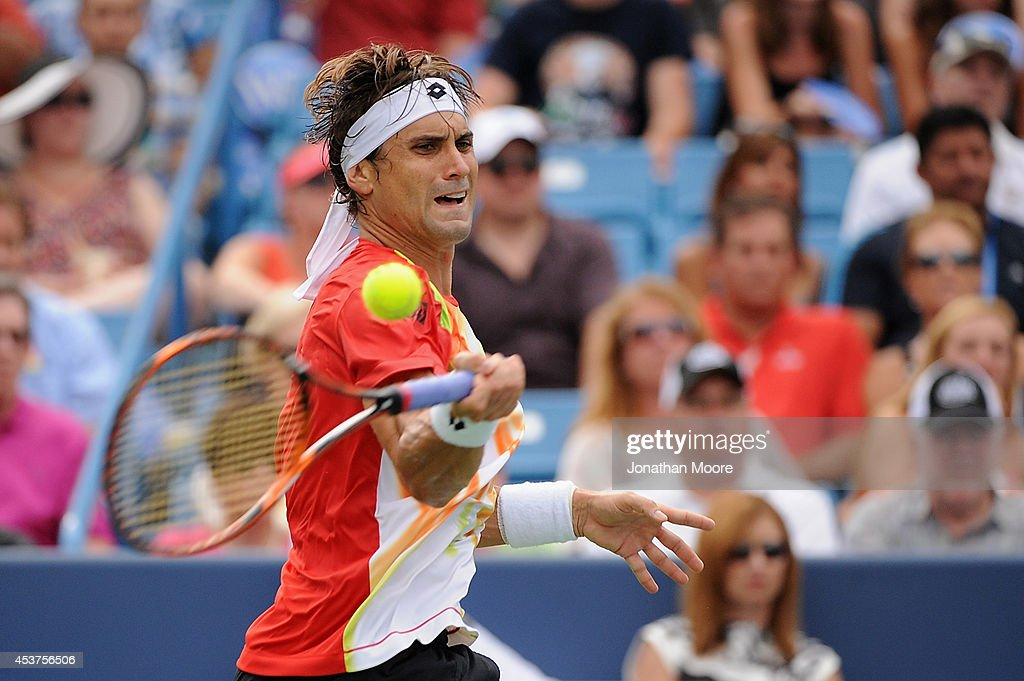David Ferrer of Spain returns to Roger Federer of Switzerland during a final match on day 9 of the Western & Southern Open at the Linder Family Tennis Center on August 17, 2014 in Cincinnati, Ohio.