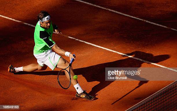 David Ferrer of Spain runs to play a forehand volley against Rafael Nadal of Spain in their quarter final round match during day six of the...