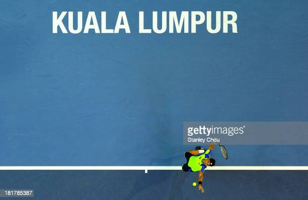 David Ferrer of Spain serves against Matteo Viola of Italy during day three of the 2013 Malaysian Open at Putra Stadium on September 25 2013 in Kuala...