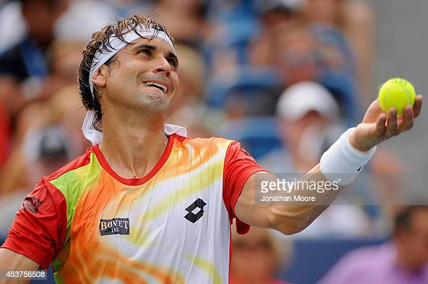 David Ferrer of Spain serves against Roger Federer of Switzerland during a final match on day 9 of the Western Southern Open at the Linder Family...