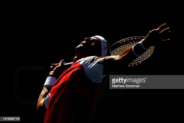 David Ferrer of Spain serves during his men's singles semifinal match against Novak Djokovic of Serbia on Day Fourteen of the 2012 US Open at USTA...