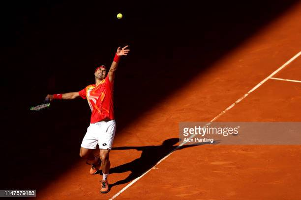 David Ferrer of Spain serves in his match against Roberto Bautista Agusta during day four of the Mutua Madrid Open at La Caja Magica on May 07 2019...