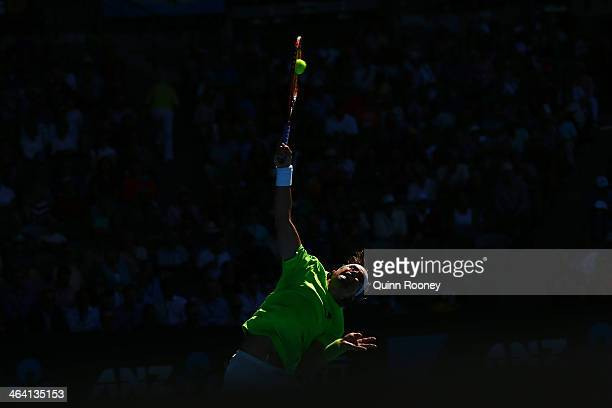 David Ferrer of Spain serves in his quarterfinal match against Tomas Berdych of the Czech Republic during day nine of the 2014 Australian Open at...