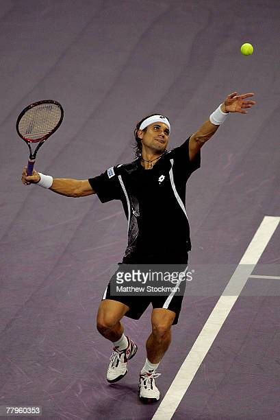 David Ferrer of Spain serves to Andy Roddick of the United States in the semifinals November 17 2007 during the Tennis Masters Cup at Qi Zhong...