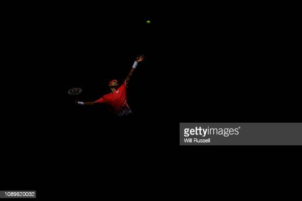 David Ferrer of Spain serves to Lucas Pouille of France during day seven of the 2019 Hopman Cup at Perth Arena on January 04 2019 in Perth Australia