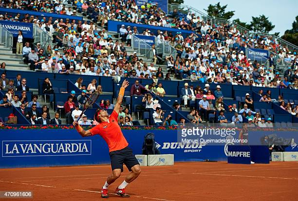 David Ferrer of Spain serves to Philipp Kohlschreiber of Germany during day five of the Barcelona Open Banc Sabadell at the Real Club de Tenis...