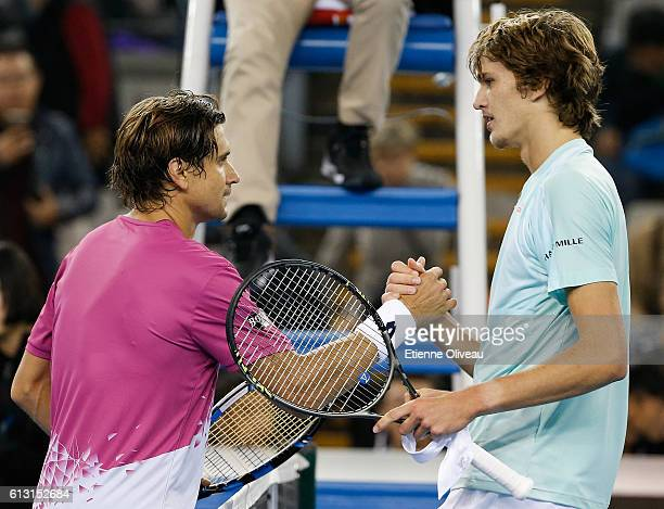 David Ferrer of Spain shakes hands with Alexander Zverev of Germany after the Men's Singles Quarter Finals match on day seven of the 2016 China Open...