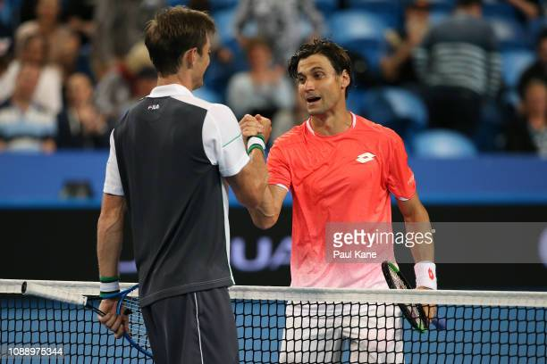 David Ferrer of Spain shakes hands with Matt Ebden of Australia after winning the men's singles match during day five of the 2019 Hopman Cup at RAC...