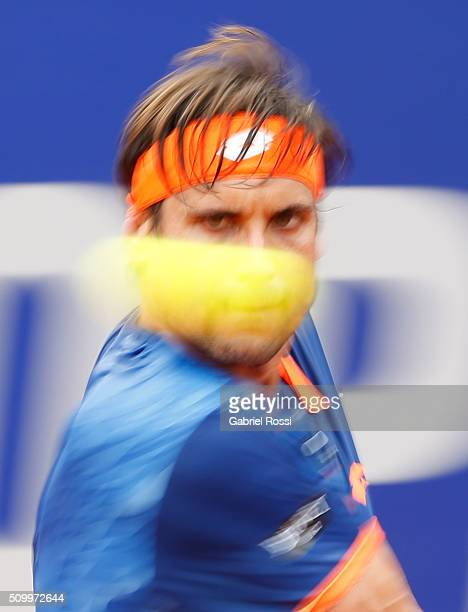 David Ferrer of Spain takes a backhand shot during a match between Pablo Cuevas of Uruguay and David Ferrer of Spain as part of ATP Argentina Open at...