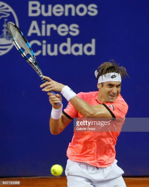 David Ferrer of Spain takes a backhand shot during a second round match between David Ferrer of Spain and Carlos Berlocq of Argentina as part of ATP...