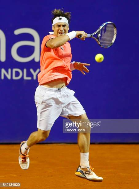 David Ferrer of Spain takes a forehand shot during a second round match between David Ferrer of Spain and Carlos Berlocq of Argentina as part of ATP...