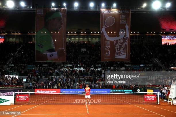 David Ferrer of Spain takes in the moment as the stadium applaud his last ever match during day five of the Mutua Madrid Open at La Caja Magica on...