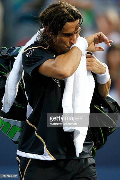 David Ferrer of Spain walks off the court after retiring from his match against Rafael Nadal of Spain during the Rogers Cup at Uniprix Stadium on...