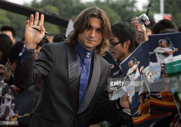 David Ferrer signs autographs as he arrives for the opening ceremony of the Tennis Masters Cup at the Science and Technology Museum on November 10...