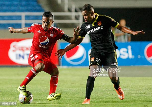 David Ferrerira of America de Cali fights for the ball with Oaldier Morales of Bogota during a match between America de Cali and Bogota FC as part of...