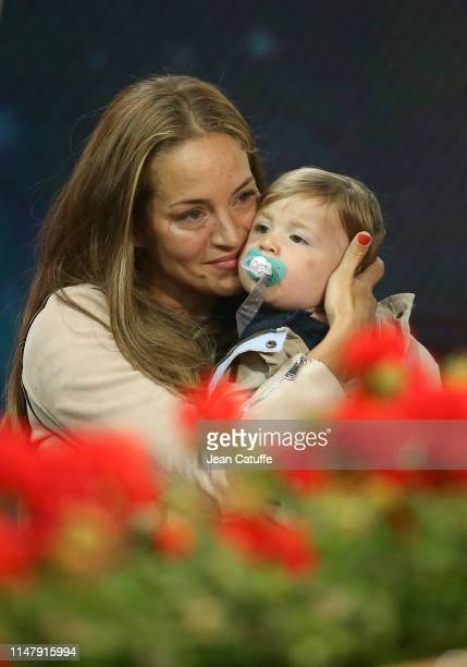 David Ferrer's wife Marta Tornel and their son Leo Ferrer attend his last match on tour against Alexander Zverev of Germany on day 5 of the Mutua...