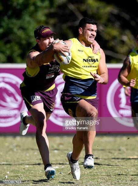 David Fifita is caught by the defence of Corey Oates during a Brisbane Broncos NRL training session on August 22 2018 in Brisbane Australia