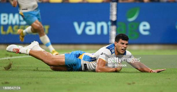 David Fifita of the Titans scores a try during the round three NRL match between the North Queensland Cowboys and the Gold Coast Titans at QCB...