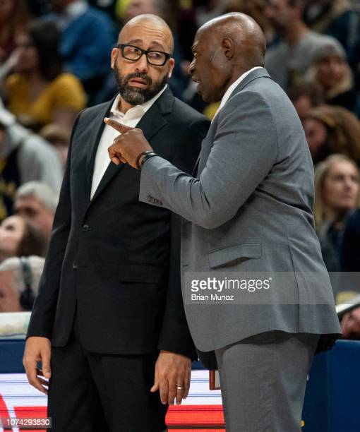 David Fizdale and Keith Smart of the New York Knicks talk during the first half of the game against the Indiana pacers at Bankers Life Fieldhouse on...