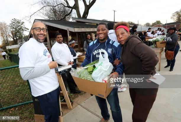 David Fizdale of the Memphis Grizzlies participates in a Thanksgiving giveaway on November 21 2017 at Green Leaf Learning Farm in Memphis Tennessee...