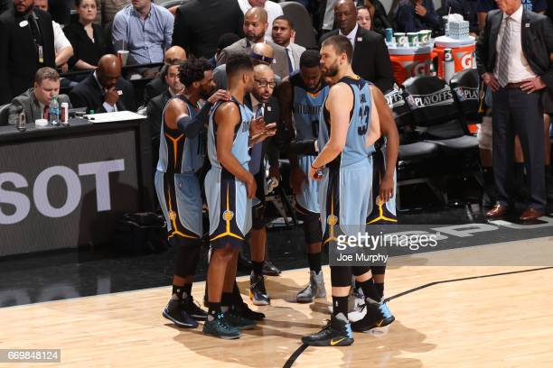 David Fizdale of the Memphis Grizzlies talks with his team during a time out against the San Antonio Spurs during Game Two of the Western Conference...