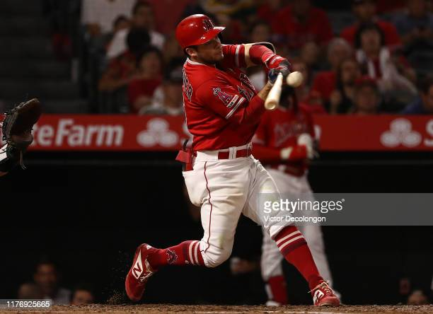 David Fletcher of the Los Angeles Angels hits a single during the third inning of the MLB game against the Oakland Athletics at Angel Stadium of...