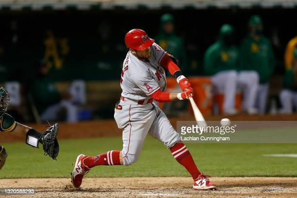 David Fletcher of the Los Angeles Angels hits an RBI single in the top of the seventh inning against the Oakland Athletics at RingCentral Coliseum on...