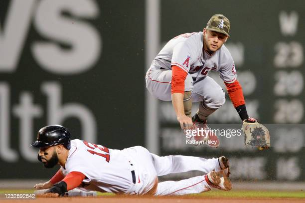 David Fletcher of the Los Angeles Angels leaps over Marwin Gonzalez of the Boston Red Sox in the fourth inning at Fenway Park on May 14, 2021 in...