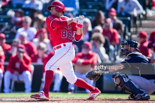 David Fletcher of the Los Angeles Angels of Anaheim bats against the Milwaukee Brewers during a Spring Training Game at Goodyear Ballpark on February...