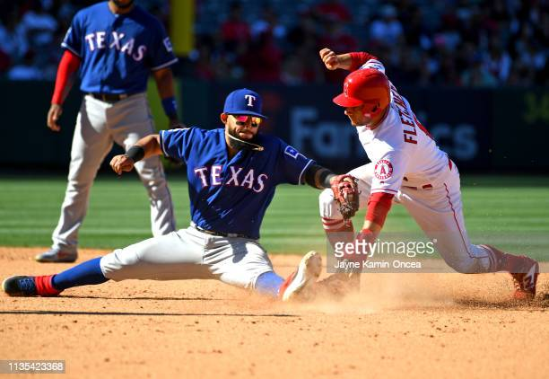 David Fletcher of the Los Angeles Angels of Anaheim beats the tag by Rougned Odor of the Texas Rangers for a double in the eighth inning of the game...