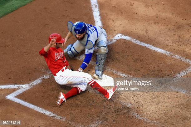 David Fletcher of the Los Angeles Angels of Anaheim is tagged out at homeplate by Russell Martin of the Toronto Blue Jays during the third inning of...