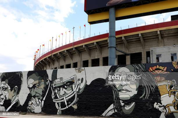 David Flores' 'World Stage Legacy' mural is displayed along the back entrance of the Los Angeles Memorial Coliseum home of the Los Angeles Rams and...