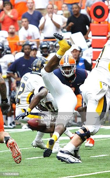 David Fluellen of the Toledo Rockets flips while running the ball against the Syracuse Orange during the game on September 24, 2011 at the Carrier...