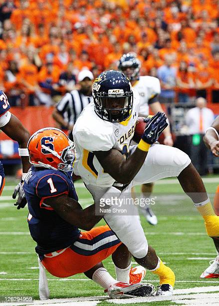 David Fluellen of the Toledo Rockets spins against Phillip Thomas of the Syracuse Orange during the game on September 24, 2011 at the Carrier Dome in...