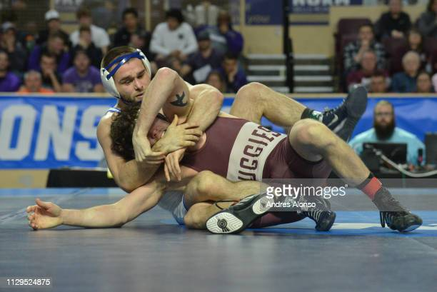 David Flynn of Augsburg defeated Chris Williams in the 141lb weight class during the Division III Men's Wrestling Championship held at on March 9,...