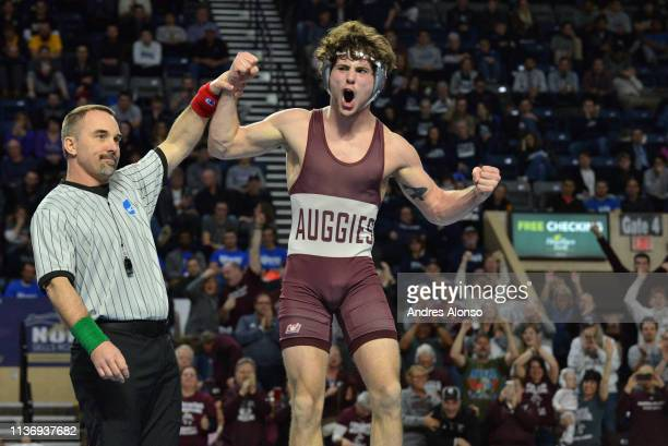 David Flynn of Augsburg wrestles Chris Williams of Millikin in the 141 lb weight class during the Division III Men's Wrestling Championship held at...