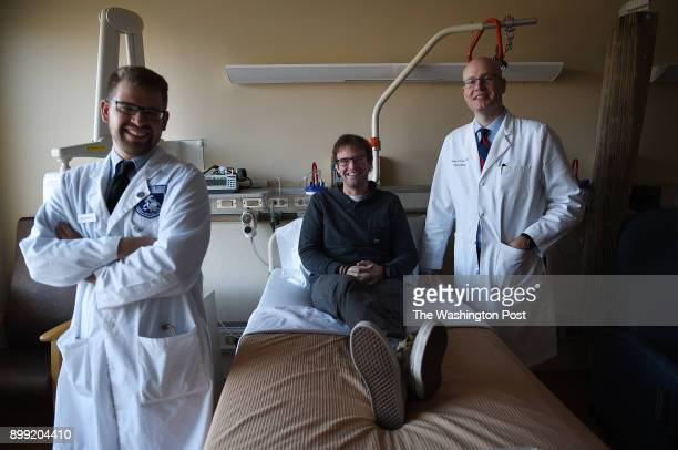 David Fogel center poses for a portrait photograph with his surgeon Dr Jeremy L Davis right surgical oncologist and Michael Wach MD surgical oncology...