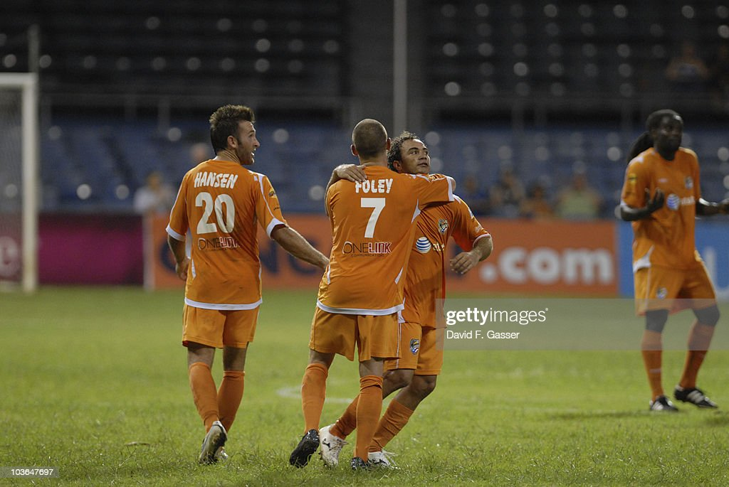 David Foley of Islanders celebrates with team mates, a goal against FAS during their match as part of 2010 CONCACAg Champions League at Juan Ramon Loubriel Stadium on August 25, 2010 in Baymon, Puerto Rico.