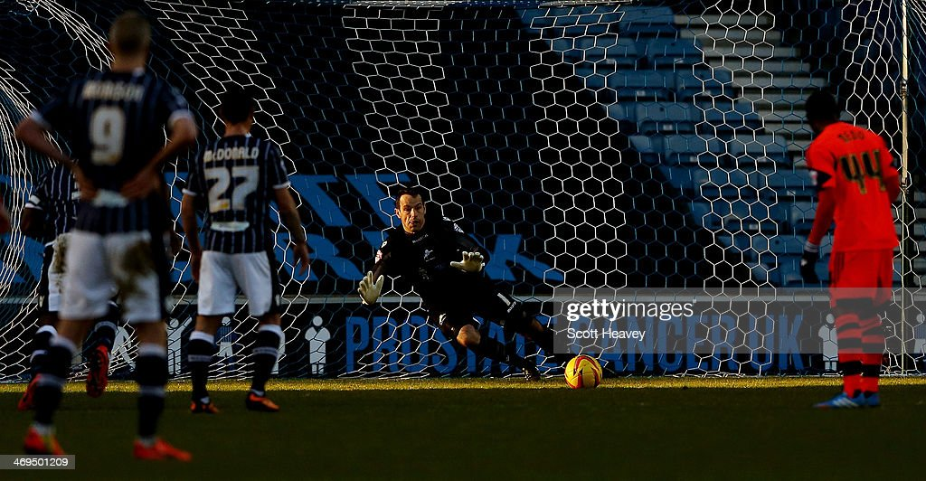 David Forde of Millwall makes a save from a Bolton penalty during the Sky Bet Championship match between Millwall and Bolton Wanderers at The Den on February 15, 2014 in London, England.