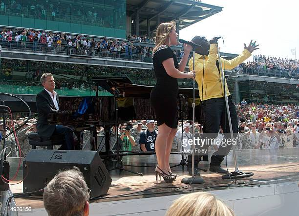 David Foster American Idol winner Kelly Clarkson and Grammy Award winner Seal perform the national anthem as a duet during the 100th Anniversary...