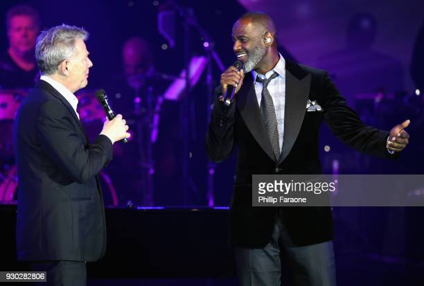 David Foster and Brian McKnight speak onstage at Celebrity Fight Night XXIV on March 10 2018 in Phoenix Arizona