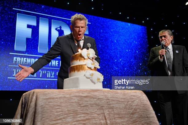 David Foster and Haim Saban speak onstage at Friends of The Israel Defense Forces Western Region Gala at The Beverly Hilton Hotel on November 1 2018...